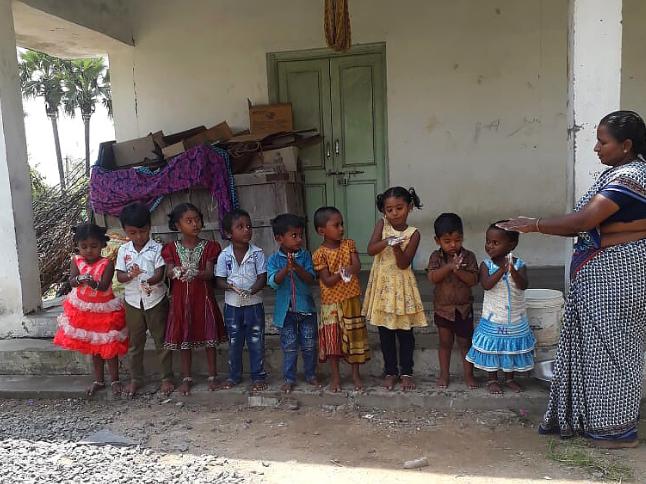 """<img src=""""200406_AanganwadiWorkHeader.png"""" alt=""""School children washing hands India"""">"""