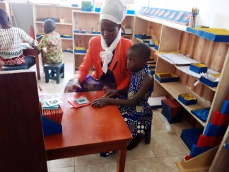 Teacher trainee with child