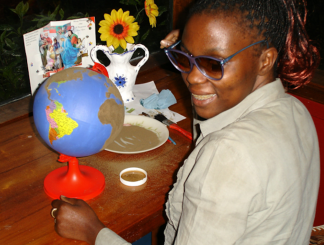 Young Jacqueline with a globe